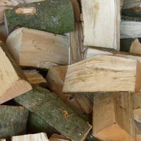 Part-seasoned hardwood logs